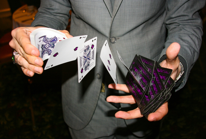 Magician shuffling cards in mid air